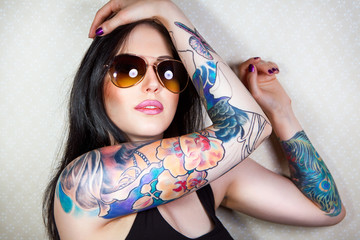 beautiful young woman with a tattoo..
