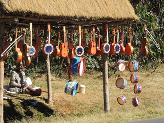 Malagasy handcrafted wooden colored trucks, Madagascar.