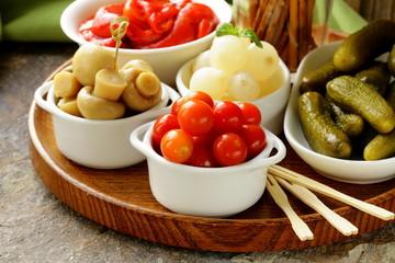pickled snacks (tapas) - mushrooms, tomatoes, cucumbers