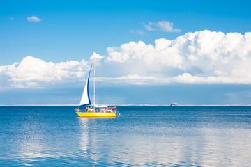 Yellow sailboat at sea