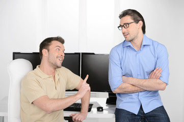 He has another point of view. Two young businessmen talking abou