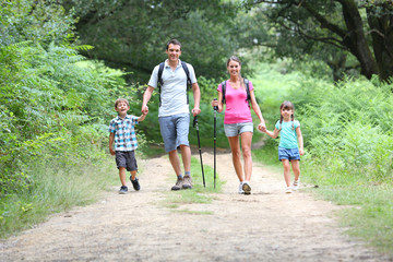 Family on a trekking day in countryside Wall mural