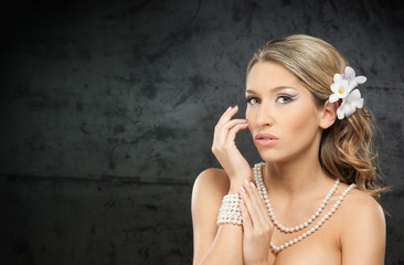 Portrait of a young blond woman in makeup in jewelry