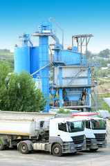 Trucks loading at a Concrete mixing factory