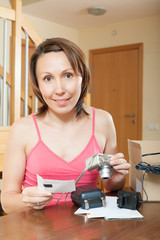 middle-aged girl unpacking new digital camera