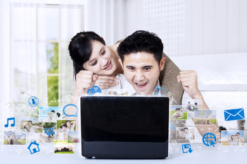Asian couple winning photo competition at home