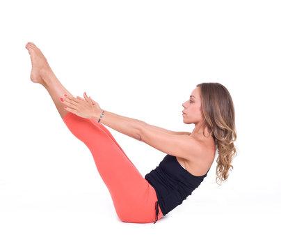Practicing Yoga exercises / Boat Pose - Navasana