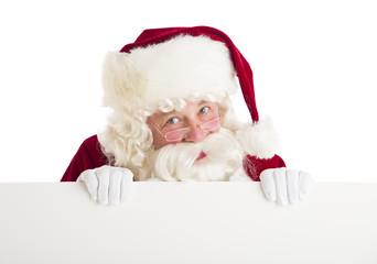 Santa Claus Peeking Through Blank Billboard