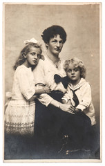 antique family portrait of mother with children wearing vintage