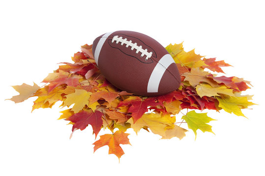 College football with fall leaves isolated on white