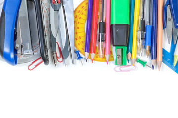 Colorful school supplies in the frame. On a white background. Cl