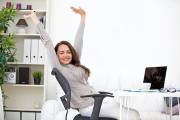 woman stretching at workplace