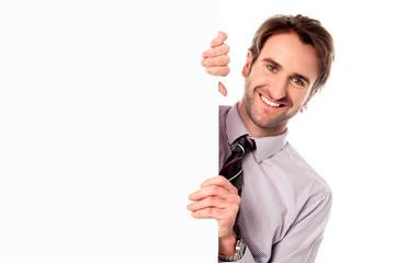Male model holding blank white ad board