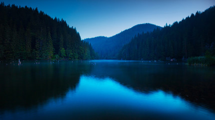 Printed kitchen splashbacks Lake Blue serenity on a lake very early in the morning