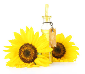 Oil in jar and sunflower isolated on white