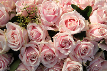 Pink roses in a wedding centerpiece