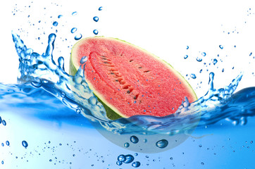 Watermelon splash in the water over white background
