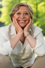 Smiling senior woman looking at camera