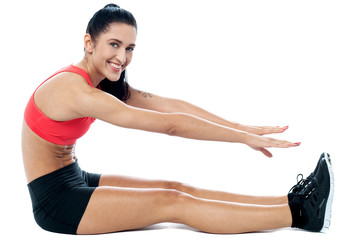 Female gym instructor stretching her body