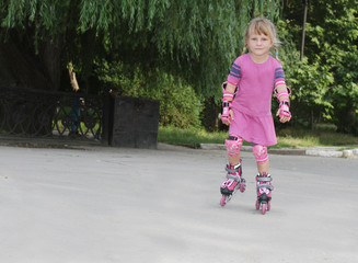 young happy firl riding roller blades outdoor