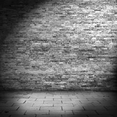 dark brick wall background in basement with beam of light