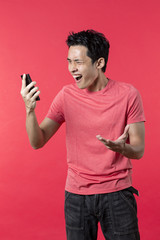 Portrait of Angry Chinese man on phone.
