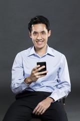 Chinesebusiness man using a smart phone.
