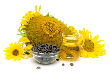 Sunflower seeds, flowers and oil on a white background