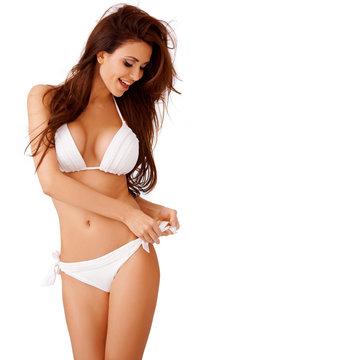 Laughing sexy young woman in a white bikini