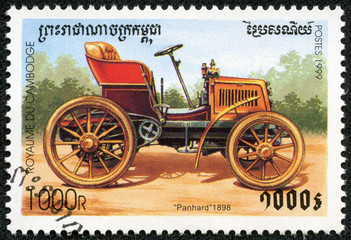 stamp printed by Cambodia, shows retro car
