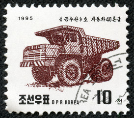 stamp printed in North Korea shows a Kamsusan tipper truck