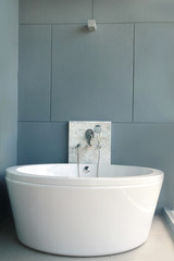 White bath on a gray background, bathtub
