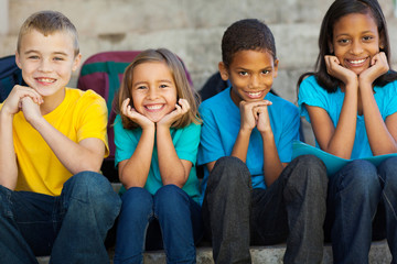 primary school children sitting outdoors