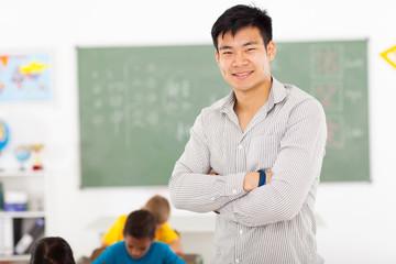 male asian elementary school teacher