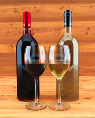 Red and white wine on a wooden background