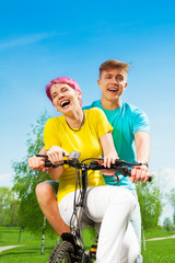 Laughing couple on the bike
