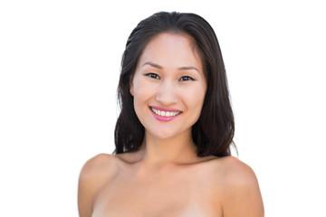 Smiling sensual nude brunette posing