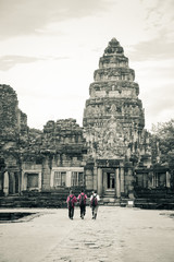 Three boys are walking to Pimai rock castle, Thailand