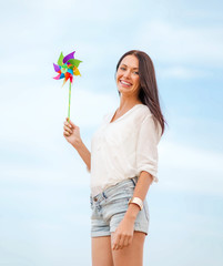 girl with windmill toy on the beach