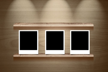 Photo frame on Brown wood show panel with lighting background