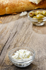 Bowl of cottage cheese on wooden table. Copy space