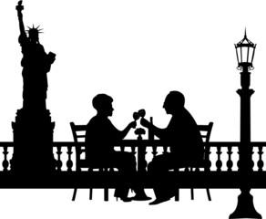 Lovely retired elderly couple drinking glass of wine in New York