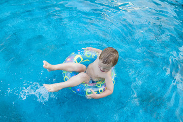 Four year old boy in swimming pool