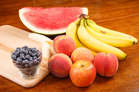 Whole and Cut Fruit on Table