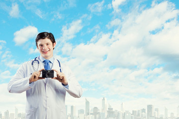 Doctor with photo camera