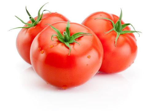 Three Juicy wet tomatoes isolated on white background