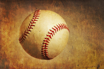 A baseball on a grunge textured background