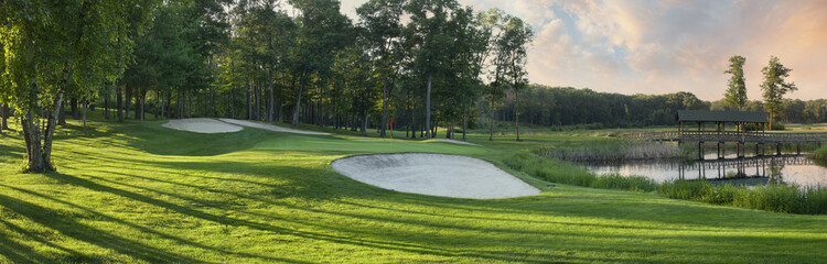 Panoramic view of golf green with white sand traps