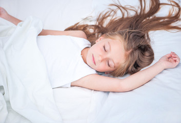 girl sleeping in white bed