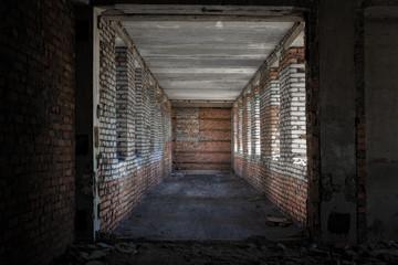 abandoned corridor with windows
